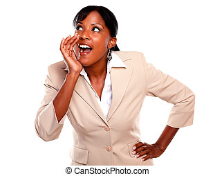 Ethnic businesswoman screaming and looking right - Ethnic...