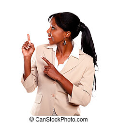 Afro-american businesswoman pointing up