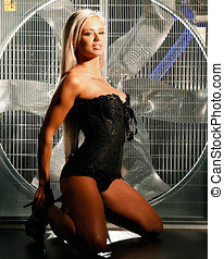 beautiful woman posing behind a huge wind fan - very sexy...