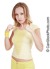 Tae-bo - Sportive agressive blond girl in yellow fitness...