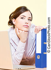 woman in office near laptop and file