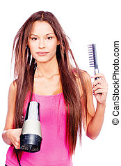woman with long hair holding blow dryer and comb, isolated...