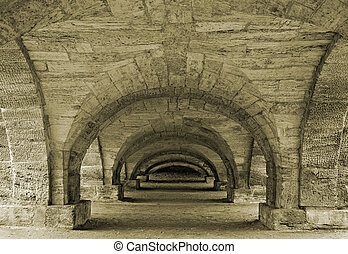 Old passage - Passage under a decorative bridge in a town of...