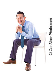 Asian businessman sitting on a chair - Full body Asian...