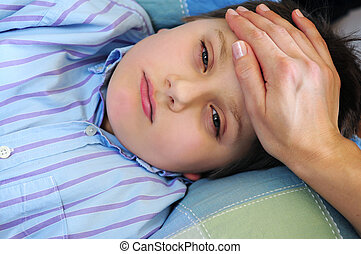 Sick child - Mother\\\'s hand feeling the forehead of a sick...