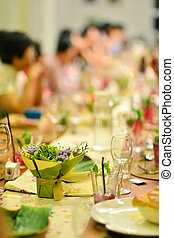Reunion party in warm ambient , focus on the flower bouquet...