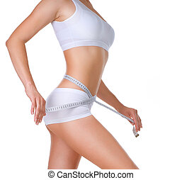 Woman measuring her waistline. Perfect Slim Body