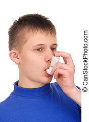 Teenager with Inhaler - Teenager holding an inhaler isolated...