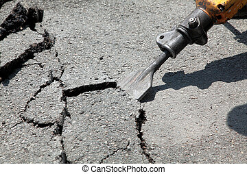 Jackhammer - Close up of asphalt demolishing with pneumatic...