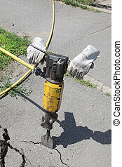 Jackhammer - Pneumatic plugger hammer with gloves at site