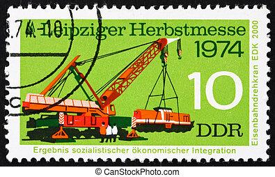 Postage stamp GDR 1974 Crane Lifting Diesel Locomotive - GDR...