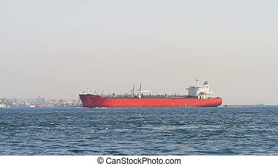 Red tanker ship sails into Bosporus Sea