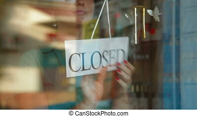 Store is Open - Business owner turns sign from closed to...
