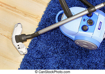 Vacuum cleaner stand on blue carpet. - Powerful vacuum...