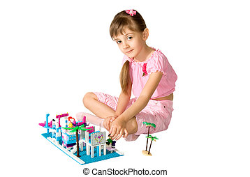 The girl with meccano - The little girl smiles and playing...