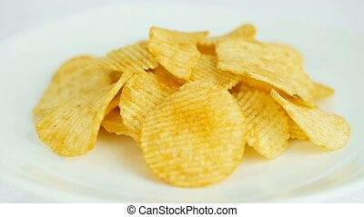 Potato chips on a white plate - rot - Potato chips on a...