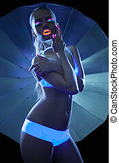 Girl with ultraviolet make-up disco dance in dark