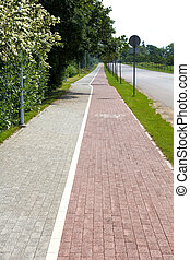 Paved sidewalk with a bicycle path