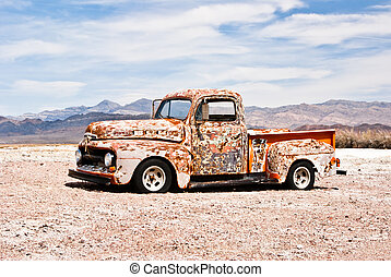 Old Truck - Abandoned vintage truck suffers in the hot...