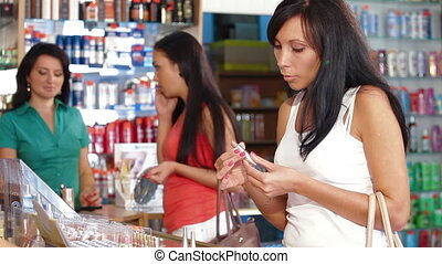 Women Testing and Buying Cosmetics