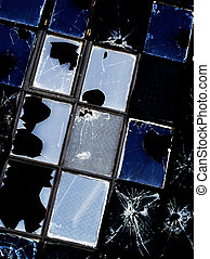 Broken Windows - Several broken windows on an old abandoned...