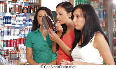 Shopping in Beauty Department - Shop assistant advising a...