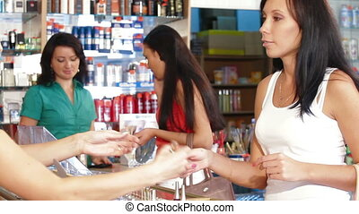 Women Shopping Cosmetics in Beauty Department