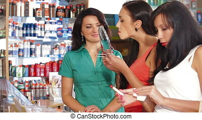 Women Shopping in Cosmetics Store