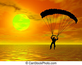 Parachutist in silhouette against a colorful sunset
