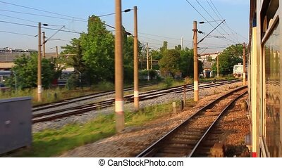 Suburban train railways. Shot from car window with wide lens