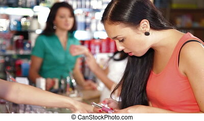 Girl Shopping in Cosmetics Store - Young Girl Testing and...