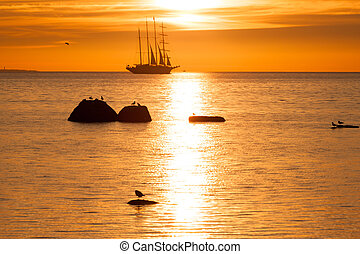 Schooner silhouette at sunset in sea