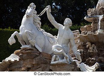 Triton statue - A triton (creature who is half-man and...