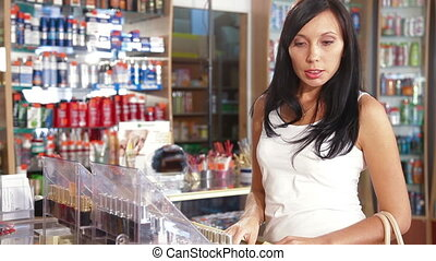 Woman Buying Beauty Care Products