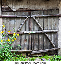 Old wooden barn door with lock