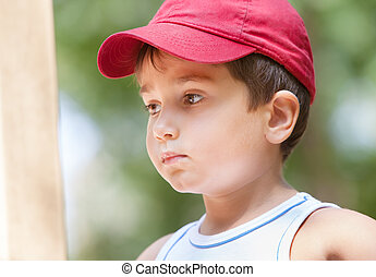 Portrait of a 3-4 years boy on the playground