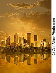 Cityscape in sunset with reflection in water (Sydney,...