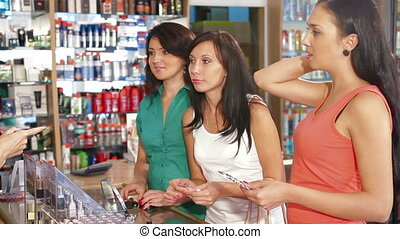 Shoppers in Choice of Cosmetics - Sales Person Assisting...