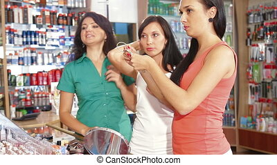Choosing Tone of Hair Dye - Brunette woman choosing blonde...