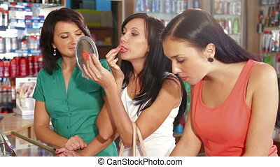 Women Applying Lip Gloss