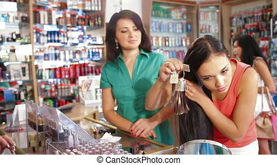 Girl Choosing Tone of Hair Dye - Female Customer Choosing...