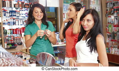 Choosing Hair Dye - Female Customers Choosing Tone of Hair...