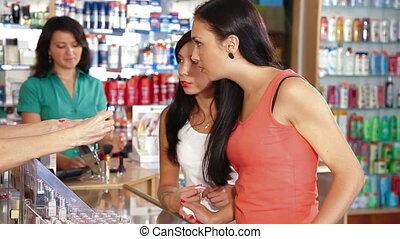 Women Shopping for Cosmetics