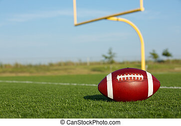 Football with Goal Posts Beyond - American Football on the...