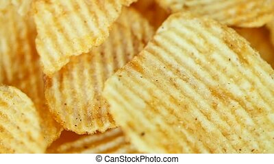 Potato chips, close-up - rotation - Potato chips, close-up -...