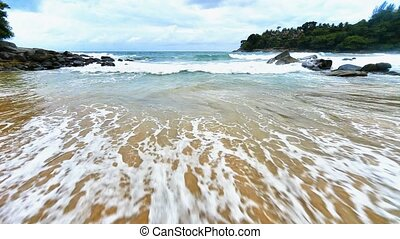 Surf with a sandy beach. Thailand, - Surf in the bay with a...