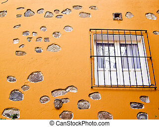 Window on gold stone wall