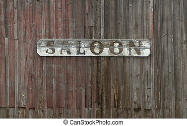 Old Saloon Sign on Weathered Wood Wall
