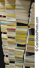 Stacks of Used Paperback Books