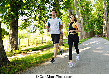 couple jogging - Young couple jogging in park at morning....